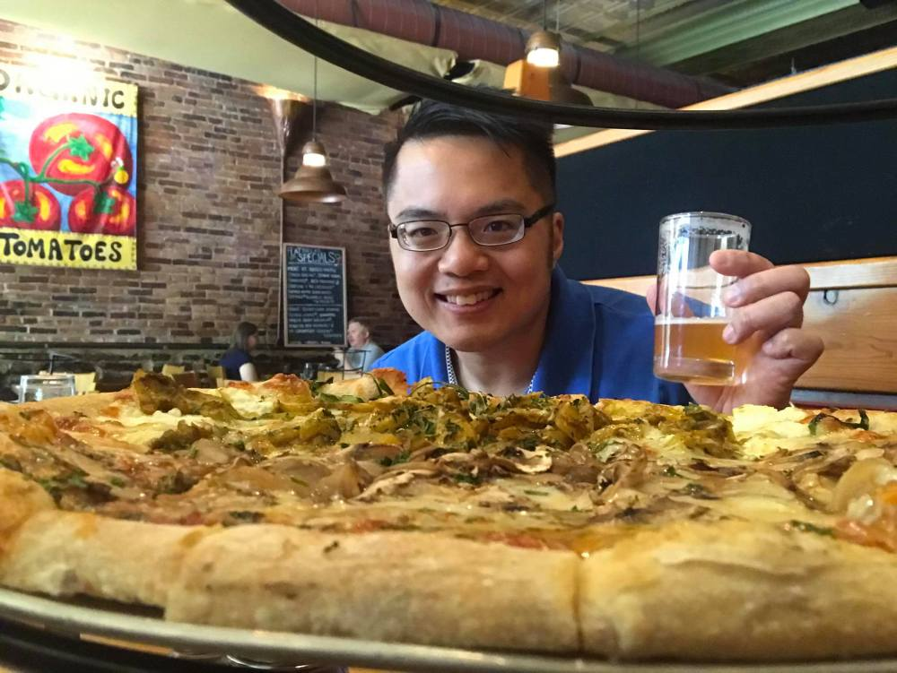Henry with IPA and pizza