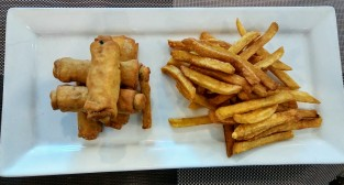 Kale-filled egg rolls with fries