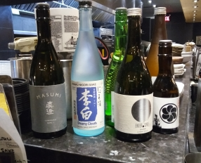 An assortment of Japanese alcohol, sitting right in front of our faces...