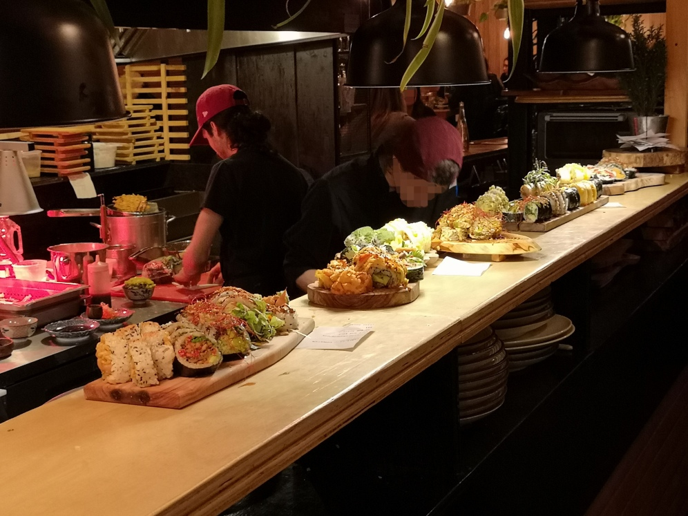 Tons of sushi being readied